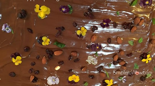 chocolate bark with nut mint and pansies up close with logo