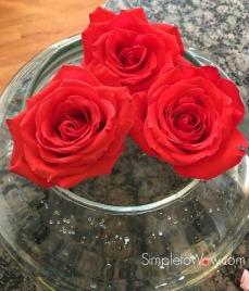 last weeks roses in large rose bowl