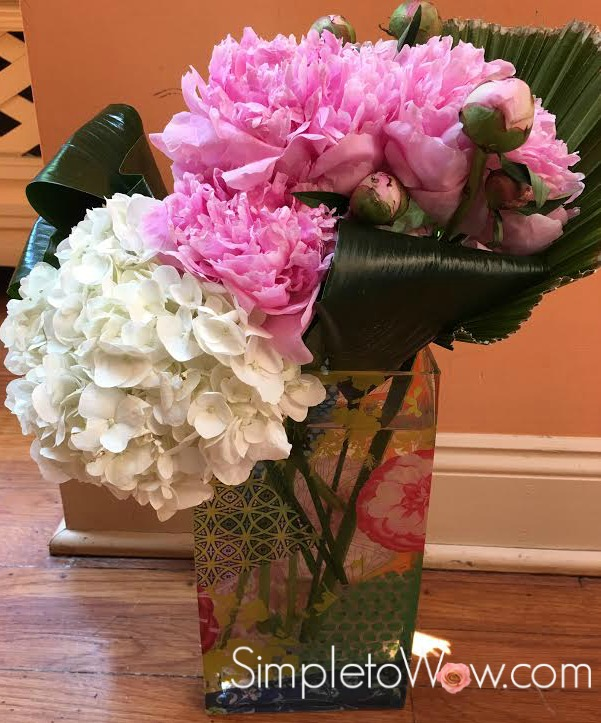 hydrangea and peony arrangement with orange background