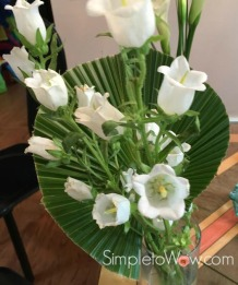 trio of floral arrangements-flowers with round trimmed leaf