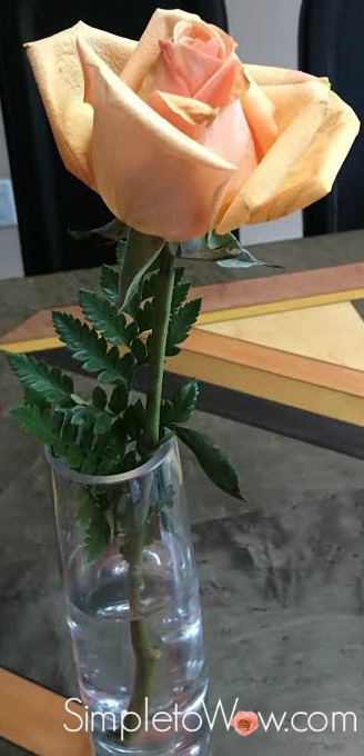 rose in single bud vase