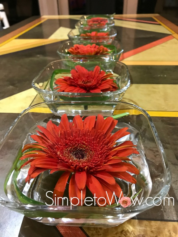 floating gerber daisies in series.JPG
