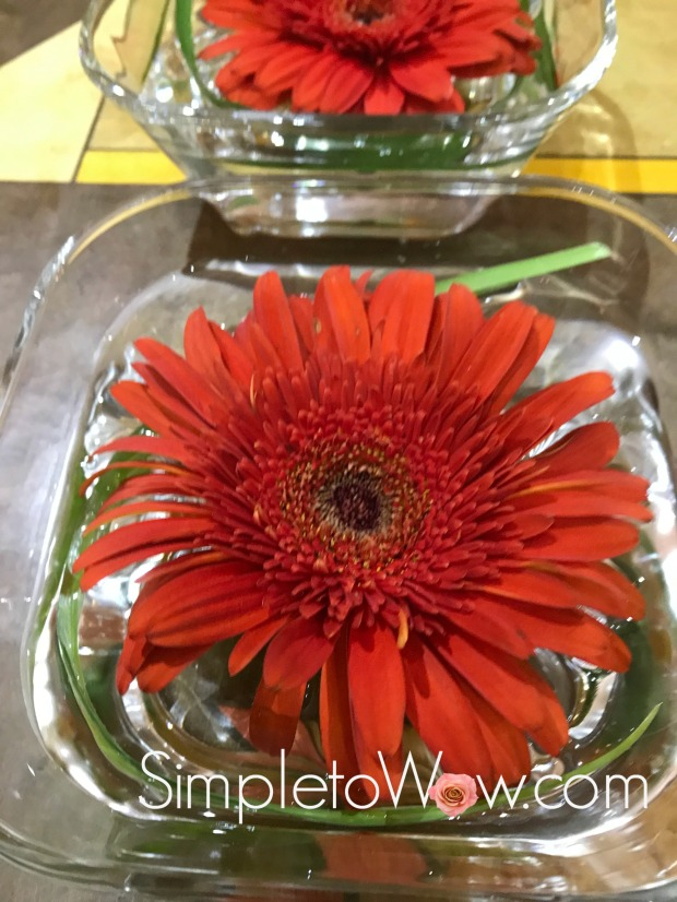 floating gerber daisies up close.JPG