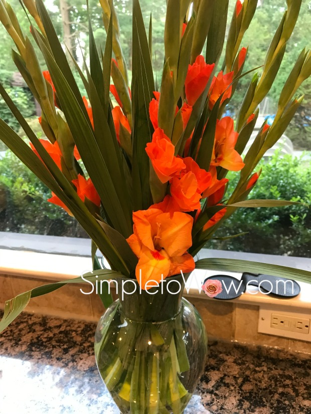 orange gladiolas after arranging