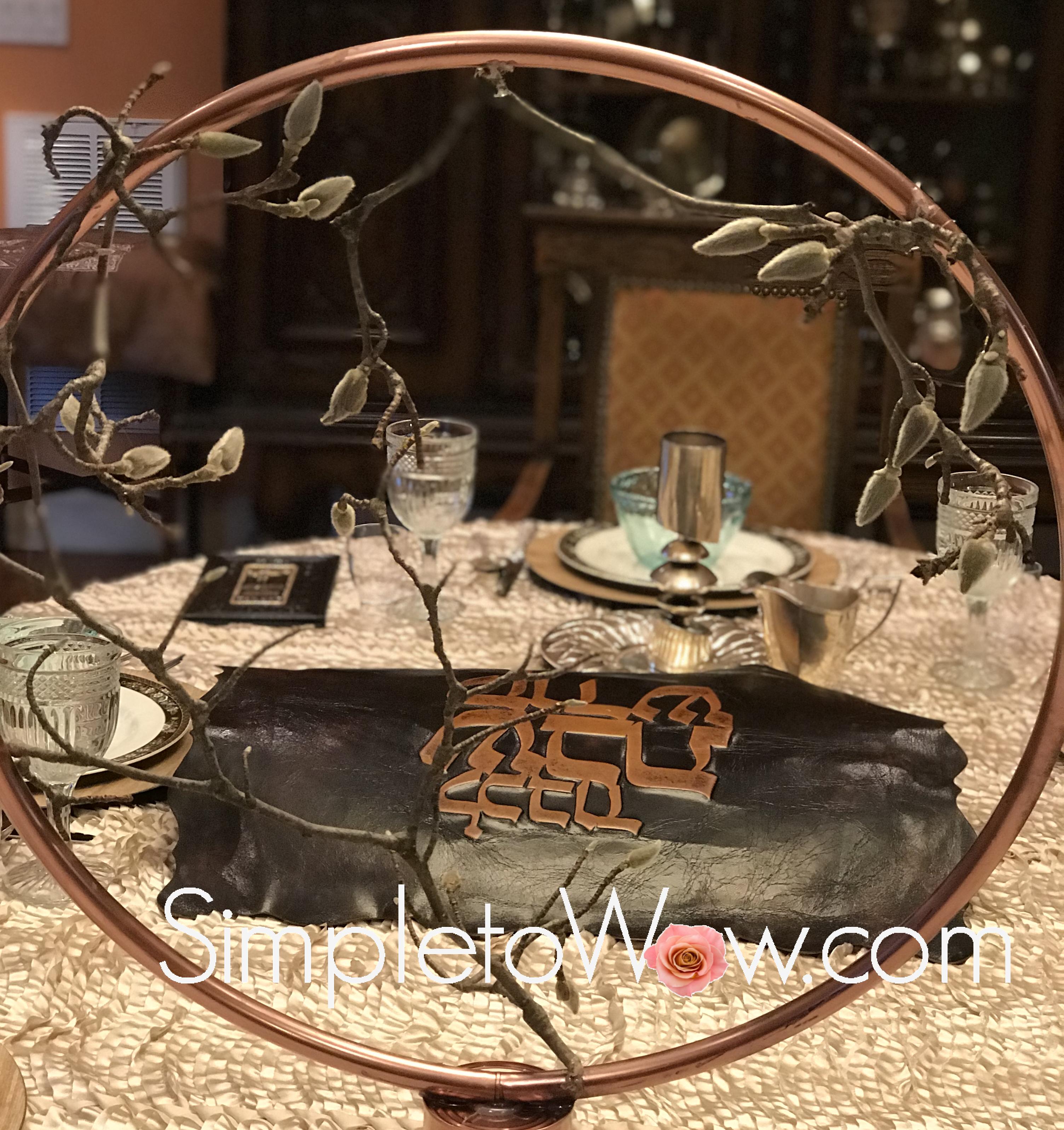 shabbos table through copper hoop arrangement